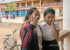 Two-school-girls-outside-their-school-at-Kampong-Phluk,-Cambodia