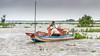 Harvesting-fish-on-Tonle-Sap-during-monsoon-season,-near-Kampong-Phluck,-Cambodia