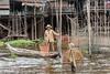 Fisherman-with-his-nets,-Kampong-Phluck-stilt-village,-Tahas-River,-Tonle-Sap,-Cambodia