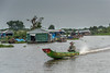 Kampong-Phluk-floating-village,-monsoon-season,-long-tail-boat,-Cambodia