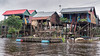 Village-life-in-the-stilt-houses-at-Kampong-Phluck-on-the-Tahas-River-during-monsoon-season,-Tonle-Sap,-Cambodia