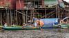Inspecting-the-nets,-Kampong-Phluck-village,-stilt-houses,-Tahas-River,-Tonle-Sap,-Cambodia