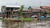 Village-life,-monsoon-season,-Kampong-Phluck-stilt-houses,-Tahas-River,-Tonle-Sap,-Cambodia
