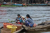 Women with a basket of small fish, Tahas River, Kampong Phluk, Cambodia
