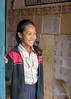 Smiling-school-girl-in-the-door-to-her-classroom,-Kampong-Phuk,-Cambodia