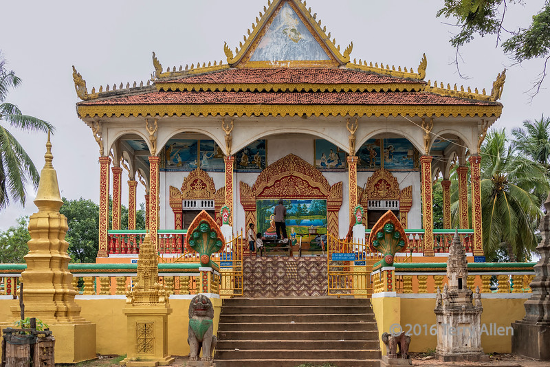 A-Buddhist-shrine-at-Kampong-Phluk-get-a-new-coat-of-paint,-Cambodia