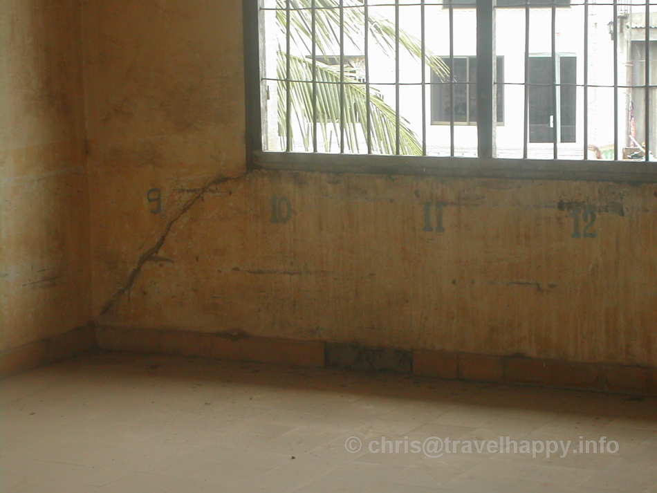Each number shows where a prisoner would have to lie down side by side. Tuol Sleng Genocide Museum, Phnom Penh