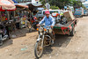 Motorbike transportation and cartage in Kampong Thom village, Cambodia, Asia.