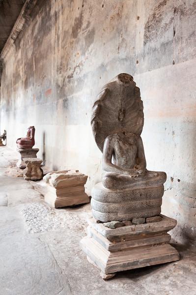Damaged Buddha Statues at Angkor Wat