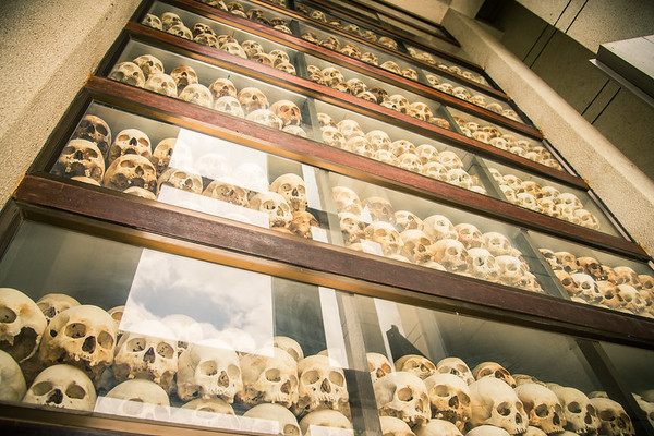 This is a memorial to those were killed by the Khmer Rouge.  Yes those are real human skulls. There are 4 walls, each dedicated to different aged skulls.