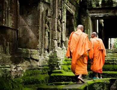 Monks walking through Angkor Wat, Cambodia
