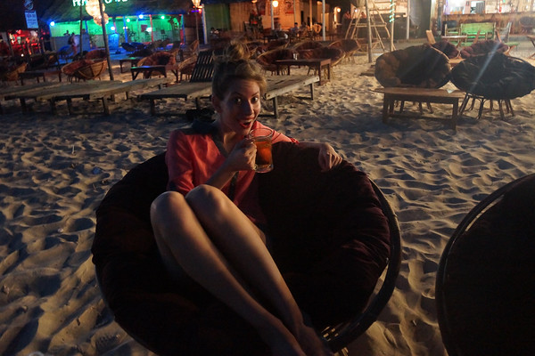 Beer in hand while enjoying dinner on the beaches of Sihanoukville, Cambodia