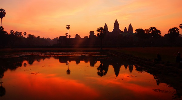 A fiery red and orange sunrise over Angkor Wat, Cambodia