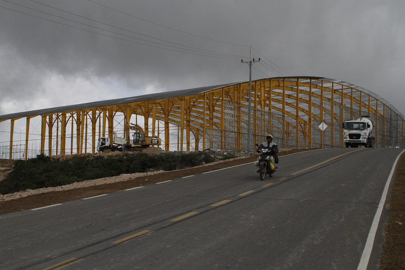 what looks like an airplane hangar being constructed, Bokor