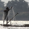fisherman checking his net at dusk, southern Ramsar site, Mekong River, 3/28/13