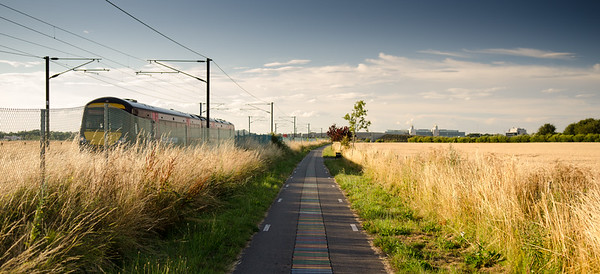 Greater Anglia train passing the DNA way path