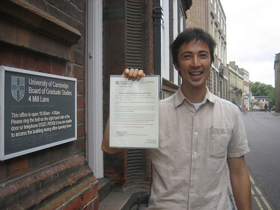 "Tobias with his ""Congratulations on handing in your thesis"" certificate. See the joy and relief in his eyes."