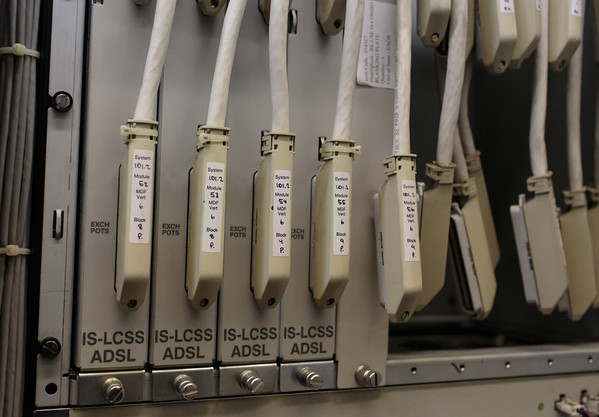From the Main Distribution Frame (MDF), the ADSL Panel Block connects to an ADSL line card. This shows Fujitsu IS-LCSS line cards. The line passes through the line card at the top and and out at the bottom back to the 'Plain Old Telephone Service' (POTS).