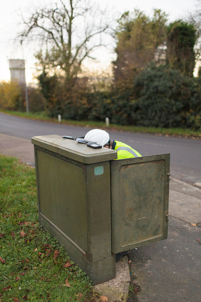 First thing in the morning, BT Openreach engineer Ben Williams is working in the  Grafham street cabinet (Nov 2013)