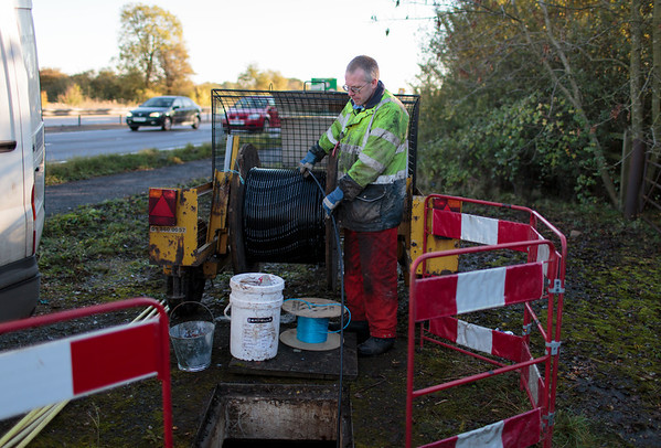 The cable (which will contain the thinner optic-fibre cable) is fed manually along the BT ducts (10 November 2013). For more information, visit http://www.increasebroadbandspeed.co.uk/cambridgeshire