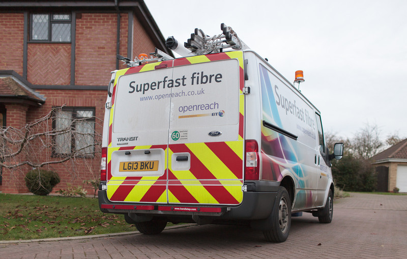 After completing work at the street cabinet, BT Openreach engineer Ben Williams parks outside the home of Grafham Broadband Champion Alastair Brydson, to start the home installation of fibre broadband (Nov 2013)