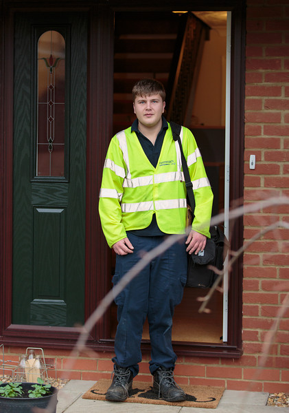 BT Openreach engineer Ben Williams departs after completing the installation, off to a fibre broadband installation in St Neots (Nov 2013)