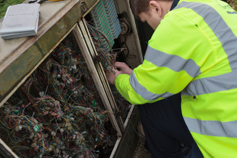 What a lot of wires! Ben Williams (BT Openreach) at the Grafham street cabinet (Nov 2013)