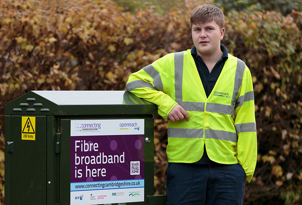 BT Openreach engineer Ben Williams next to the new fibre street cabinet in Grafham (Nov 2013)