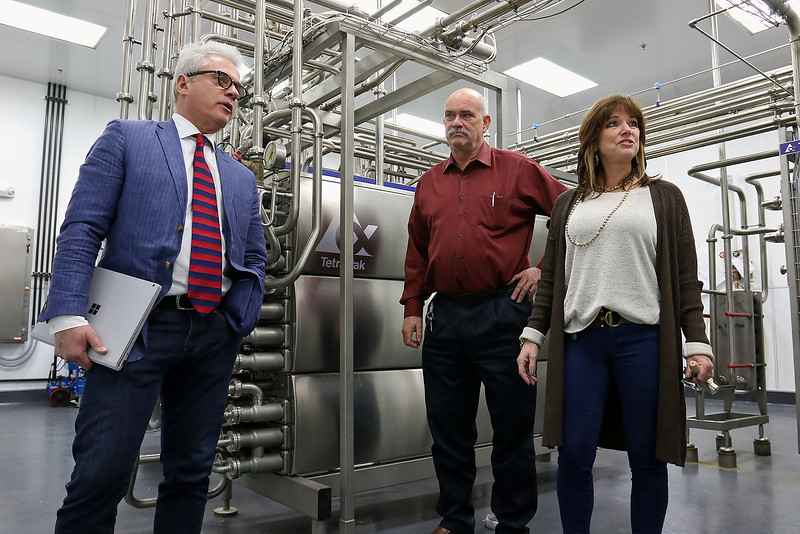 CamBrooke Therapeutics in Ayer is a company the creates food for people born with Phenylketonuria, better know as PKU. Founders David Paolella, on left, and his wife Lynn Paolella talk about the company on Friday February 17, 2017. With them is Lynn's brother Don Patterson the V.P. of operations. SUN/JOHN LOVE