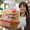 CamBrooke Therapeutics in Ayer is a company the creates food for people born with Phenylketonuria, better know as PKU. Founder Lynn Paolella shows off the hamburger buns they make at the company on Friday February 17, 2017. SUN/JOHN LOVE