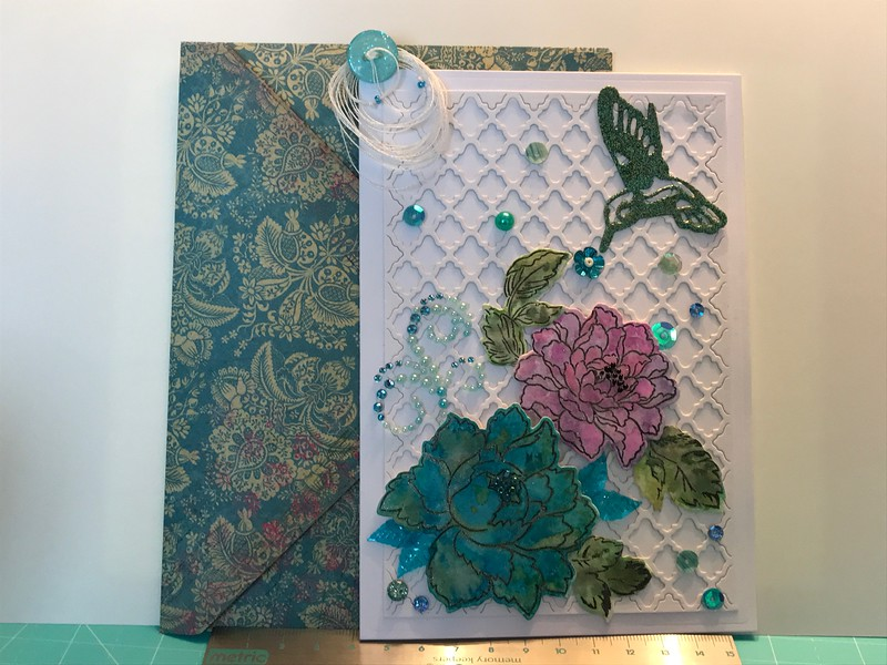 Water coloured card with flowers and hummingbird
