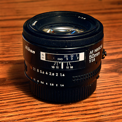 "RECOMMENDATION: <font color=""#666666"">  <br><br>  While professional f/2.8 zoom lenses are very expensive, standard f/1.8 fixed lenses are extremely affordable and about as ""fast"" as a lens can get!  50mm lenses are available for about $100, 85mm lenses are available for about $300, and assorted wide-angle lenses are available too.  Buy them used in mint condition from places like <a href=""http://www.keh.com/OnLineStore/BrandTableOfContent.aspx"">KEH.com</a>...  Yes, you do have to ""zoom with your feet"" and switch lenses more often, but most of the time you will find that it actually helps you see and make more artistic images...  <br><br>This really old Nikon 50mm f/1.4 AF lens I bought for just $199.  You can get the new Nikon 50mm f/1.4 AFS for about $450, I think.  Sigma also makes an (even better?) 50mm f/1.4, with SWEET background blur, for about the same price.  <br><br>Email me if you'd like advice on which prime or zoom lens to purchase!  <br><br><br><br></font>"