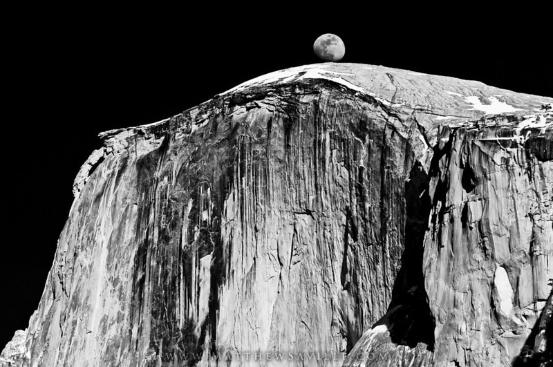 "<i>(Moon rising behind Halfdome, late February)</i> <br>Nikon D300, Sigma 150mm macro, sturdy tripod, circular polarizer.  1/90 sec @ f/5.6 & ISO 100.  RAW processed in Bridge CS3.  <br><br> It may be hard to put to words what makes a black & white image ""pop"" in general, since there is no color to pop, (hehe) so here's the best I can come up with:  ""Micro contrast, balanced with global contrast.""  The image looks very contrasty, yet highlights aren't totally blown and faint details are still visible in even the darkest shadows.  Put in other words-  The image's little details all have great contrast, yet the image as a whole is not ruined...  This comes from many minutes spent fine-tuning the exposure, brightness, contrast, highlight recovery, shadow recovery, and clarity, just to name the generic sliders found in Lightroom or Bridge.  Also, a fine-tuning of the curves layer adds even more control.  Some people prefer to work soley with sliding adjusters, some people work soley with curves; I prefer a little bit of both... <br><br> Usually you want to start with as much overall contrast as possible, and then massage the highlights and shadows individually so that they fit within the gamut of your color space again, and finally play with the brightness and exposure to make sure the mid-tones are still where they should be.  What I mean to say is, don't just crank the contrast and call it good.  Use your histogram, and your highlight / shadow warnings, to make sure you're not loosing too much detail. The most important thing is to make sure your highlights are as close to white as possible, but not actally white except for a few pixels here and there.  The same goes with the shadows, although you can let those ""go"" a little more than highlights... <br><br>"