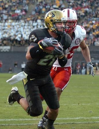 Scotty McKnight  of CU catches his first touchdown against Nebraska on Friday.<br /> <br /> Cliff Grassmick /November 27, 2009