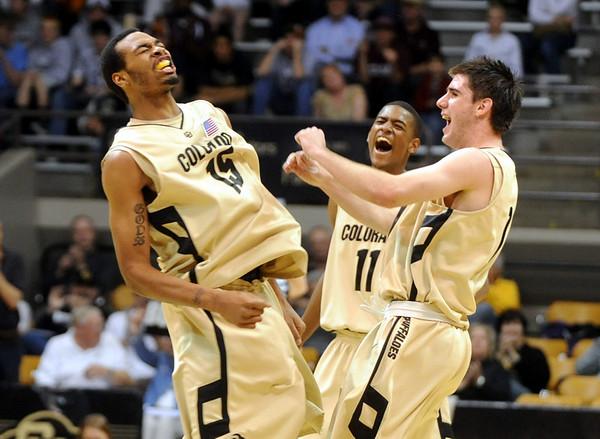 Colorado__Texas_A__M_NCAA_M.JPG Colorado__Texas_A__M_NCAA_Men_s_basketball_COBOU101.jpg Veal, Tomlinson and Higgins of CU.<br /> Cliff Grassmick / March 4, 2009