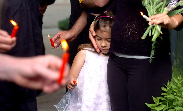 Sofia Joesaar, 4, listens to speakers with her mother Maria at the memorial. They live less than a block away of the DiLeo home.<br /> Neighbors of Elizabeth Schwarzenbach-DiLeo, her son Philip Christopher, and husband Philip, held a memorial service outside the home on Bluff Street in Boulder on Saturday. Elizabeth and Philip Christopher were victims of the murder-suicide of Philip Frank DiLeo.<br /> Cliff Grassmick / May 30, 2009