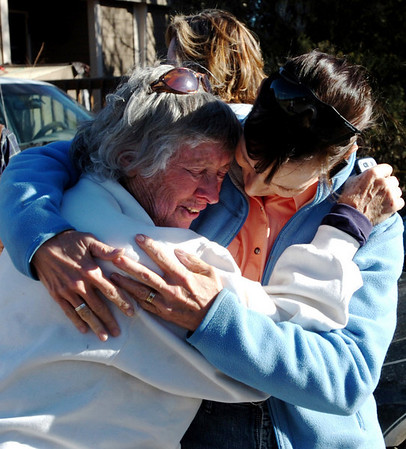 Bobra Goldsmith, left, is hugged by friend Kris Paige, after returning to her home on Thursday.<br /> Llama Rancher, Bobra Goldsmith, lost her home to one of the wind generated fires.  No people or llamas were injured at the ranch at 7202 45th Street.<br /> Cliff Grassmick/ January 8, 2009