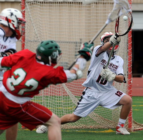 S0501FVLC118.JPG S0501FVLC118.JPG Goalie Brycen Zolnick, right, of Fairview, makes the save on a shot by Andy Weir of Smoky Hill on Thursday.<br /> Cliff Grassmick / April 30, 2009