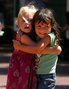 Sofia Box, 3, left, and Camille Placer, 4,  have a hug for each other after dancing at BoulderFest downtown Boulder's newest festival, It will bring together the best local bands, brews, wines, and food on the Pearl Street  Friday and Saturday. For more photos and a video, go to www.dailycamera.com. Cliff Grassmick / August 21, 2009