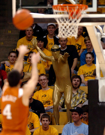 """An unidentified CU Buff """"super hero"""" tries to put a hex on the free throw of Dogus Balbay of Texas.<br /> Cliff Grassmick / February 14, 2009"""