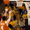 "An unidentified CU Buff ""super hero"" tries to put a hex on the free throw of Dogus Balbay of Texas.<br /> Cliff Grassmick / February 14, 2009"