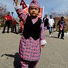 Rishab Karki, 2, proudly marches with the U.S. flag to lead the Nepal New Year  parade around  Boulder.<br /> Local Nepalese celebrated the Nepal New Year of 2066 with a parade around downtown Boulder, Japanese drums on the Pearl Street Mall, and  with food and a cultural program in Boulder.<br /> Cliff Grassmick / April 19, 2009