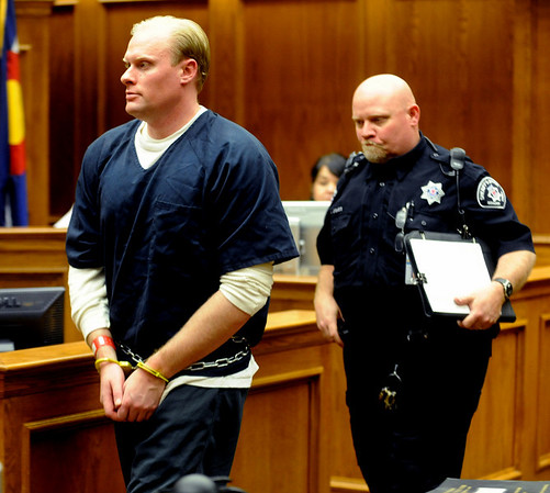 Alex Midyette was sentenced to 16 years, followed by 5 years of parole, for neglect in the death of his infant son, Jason. He is led out of the courtroom after the sentencing.<br /> Cliff Grassmick / May 15, 2009