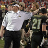 Coach Dan Hawkins pats Scotty McKnight after Scotty's second touchdown.<br /> Cliff Grassmick /November 27, 2009