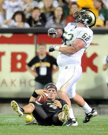 James Morehead of CSU celebrates a sack on a frustrated Cody Hawkins in the Buff loss.<br /> Cliff Grassmick / September 6, 2009