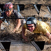 "Andy Call, left, and his brother, Matt, work through the mud pit of the Muddy Buddy race.<br /> The Muddy Buddy Ride and Run requires a 2-person team to finish a 6-7 mile course with 5 obstacles. One member will ride and one will run, but they need to finish together. The race was held at the Boulder Reservoir on Sunday.<br />  For more photos and a video, go to  <a href=""http://www.dailycamera.com"">http://www.dailycamera.com</a>.<br /> <br /> <br /> Cliff Grassmick / August 16, 2009"