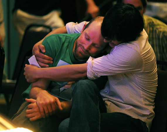 Peter Mortimer, left, is comforted by Robb Shurr during the memorial service for the climbers<br /> A memorial service celebrating the lives of Jonny Copp, Micah Dash, and Wade Johnson was held Saturday at the Boulder Theater. The three men died in an avalanche this spring while on a climbing expedition in western China's Sichuan province.<br /> <br /> Cliff Grassmick / July 11, 2009