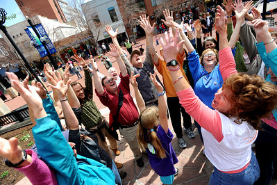 Ellen Brown, bottom right, leads a group in a laughter therapy exercise. Sunday, May 3, 2099 was World Laughing Day. About 20 people celebrated the occasion on the Pearl Street Mall. Cliff Grassmick / May 3, 2009