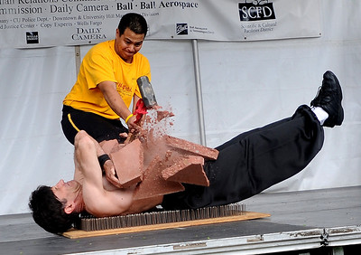 Rama Kho is  hitting  blocks  with a sledge hammer that are on the stomach of Shifu Solow, who is lying on a bed of nails. Both men are part of Shaolin Hung Mei Kung Fu of Boulder. The 15th Annual Boulder Asian Festival is being held on the Pearl Street Mall and continues at 11 a.m. on Sunday. For more photos and a video, go to www.dailycamera.com. Cliff Grassmick / August 15, 2009
