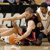 Mike Bogar of Western State, gets to the ball while sitting on Jermyl Jackson-Wilson during the first half of the January 7, 2009 game in Boulder.<br /> Cliff Grassmick / January 7, 2009